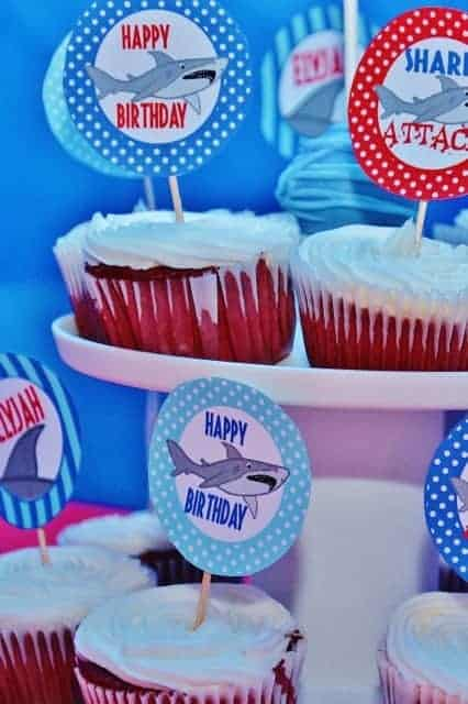 Shark Party: Elyjah's Shark Attack. Let's take a bite out of this birthday party with a shark party theme!! Check out this fun shark themed party.#shark #sharkparty #party #partyideas #parties #boy #pool #poolparty #birthday