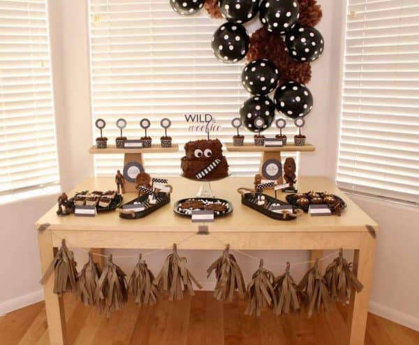 Looking for some fun Star Wars party inspiration? This star wars party theme is all about the wookiee. Easy and inexpensive Chewbacca desserts and decor with simple modern printables. Throw a star wars party with easy diy treat ideas. #starwars #partyideas #diyparty #chewbacca #wookieecake