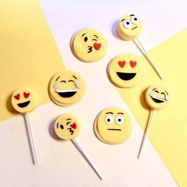 Emoji Birthday Party: DIY Emoji Oreo Pops and DIY Emoji Cookies. If you are thinking about throwing an emoji birthday party for your little one, we have some easy tutorials for making your own emoji cookies and emoji oreo pops. #parties #holiday #kidbirthday #birthdays #diyandcrafts #baking #emoji #birthdayparty #emojiparty #emojis